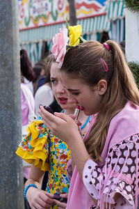 Young girls put on makeup, Seville.