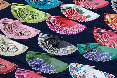Hand-painted personal fans for sale.