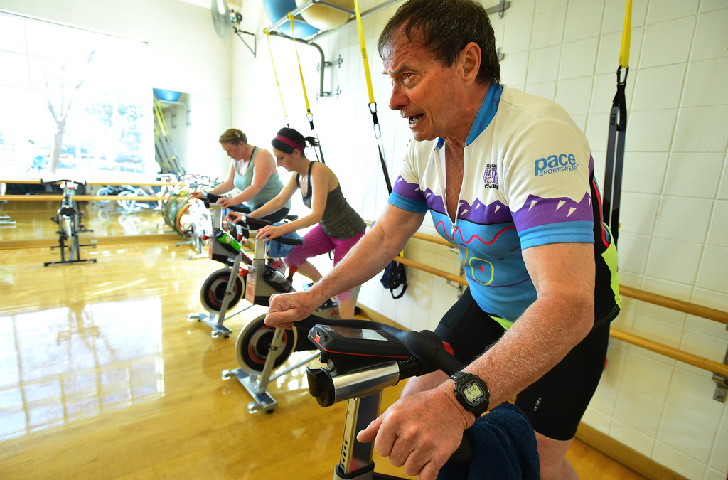 . George Weber gets up out of his seat during a tough portion of The Ride! class at the East Boulder Community Center on Thursday. For more photos go to www.dailycamera.com Paul Aiken Staff Photographer April 6, 2017