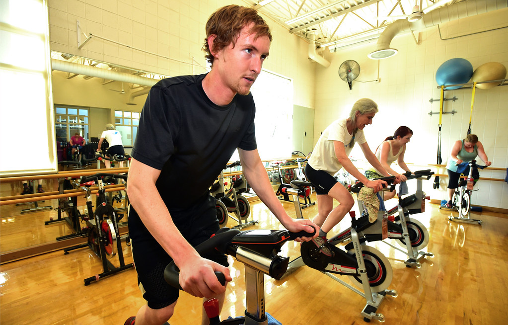 . Jessie Lennox gets up out of his seat during a tough portion of The Ride! class at the East Boulder Community Center on Thursday. For more photos go to www.dailycamera.com Paul Aiken Staff Photographer April 6, 2017