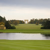 View across the Octagon Lake towards the Lake Pavilions and Corinthian Arch at Stowe Landscape Gardens, Buckinghamshire