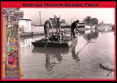 "Caption:  ""40 Years Ago On The Venice Canals""  This press photo from 1971 shows the canal clean-up gang as they pole along through their daily routine.  Stagnant and debris filled with crumbling banks, the remaining Southern canals were something far from their current manicured & desirable glory.  It was about this time that street poet Claire Horner deemed Venice, ""Where the Debris meets the Sea"".  Canal resident MaryJane recalls Domingo as the skipper in the photograph while the crew members remain unidentified.  Paul Tanck remembers the vessel being moored near his then-residence on Eastern Canal - locals called it the ""Garb-Barge"".  Ah, but I'll bet they discovered some treasures too...  Courtesy:  www.VeniceHeritageMuseum.org"