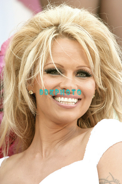 "ATLANTIC CITY - JUNE 11:  Pamela Anderson joined Melania and Donald J. Trump along with other guests for a special ""Donald J. Trump Birthday Quarter Million Dollar Giveaway,"" celebration on Saturday, June 11, 2005  in Atlantic City, New Jersey."