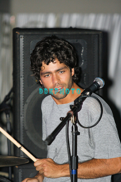 "ATLANTIC CITY, NJ - SEPTEMBER 3, 2007  Adrian Grenier plays drums with his band The Honey Brothers at the ""Entourage"" party at The Pool at Harran's Atlantic City in the early morning hours of September 3, 2007 in Atlantic City, New Jersey."