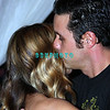 ATLANTIC CITY, NJ - MAY 23  Carmen Electra poses for photographers as her fiance' Rob Patterson from the band Korn gives her a kiss at The Pool in Harrah's Resort for an appearance on May 23, 2008 in Atlantic City, New Jersey. (Photo by Donald Kravitz/Getty Images)