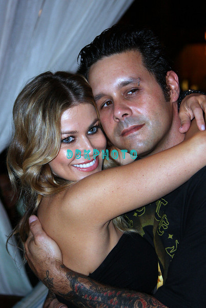 ATLANTIC CITY, NJ - MAY 23  Carmen Electra poses for photographers with her fiance' Rob Patterson from the band Korn at The Pool in Harrah's Resort for an appearance on May 23, 2008 in Atlantic City, New Jersey. (Photo by Donald Kravitz/Getty Images)