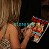"""ATLANTIC CITY, NJ - FEBRUARY 16  Kendra, one of the stars of """"The Girls Next Door,"""" and current Playboy Cover Girl signs a cover of Playboy Magazine for a fan as shesappears at The Pool in Harrah's Resort on February 16, 2008 in Atlantic City, New Jersey."""