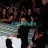 ATLANTIC CITY, NJ - MARCH 8  Sexy socialite  Kim Kardashian and her friend Carla DiBello sit down as her fans look on as she appears at The Pool in Harrah's Resort on March 8, 2008 in Atlantic City, New Jersey.
