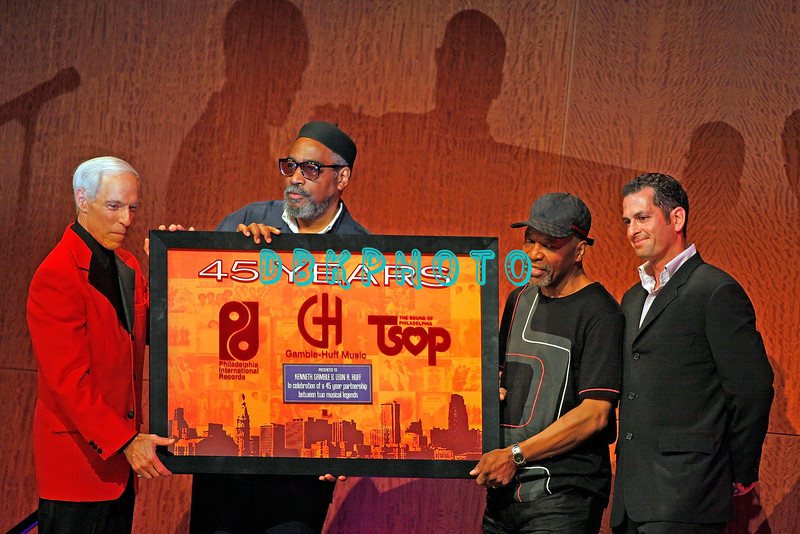 "ATLANTIC CITY - JUNE 07:  Emcee Jerry Blavat(L)  joins Kenneth Gamble and Leon Huff (C) and record company Vice President (R) as they are presented with a plaque for their The Sound Of Philadelpia music at the ""Love Train: The Sound Of Philadelphia"" concert on June 7, 2008 at the Borgata Hotel & Casino in Atlantic City, New Jersey."