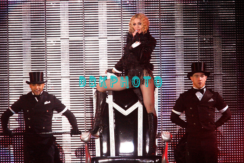 """ATLANTIC CITY, NJ - NOVEMBER 22:  Madonna and back-up dancers performs during her """"Sticky & Sweet"""" tour at Boardwalk Hall on November 22, 2008 in Atlantic City, New Jersey."""