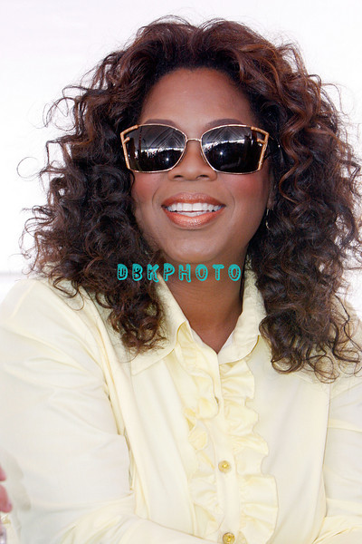 WHITESBORO, NJ - AUGUST 30:  Oprah Winfrey waits her turn at the mike as she reacts to the fun at the 20th Reunion Festival in Whitesboror, NJ where Oprah is the honored speaker.
