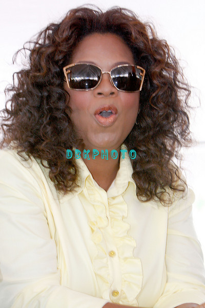 WHITESBORO, NJ - AUGUST 30:  Oprah Winfrey waits her turn at the mike as she reacts to the fun at the 20th Reunion Festival in Whitesboror, NJ where Oprah is the honored speaker.  (Photo by Donald Kravitz/Getty Images) *** Local Caption *** Oprah Winfrey