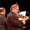 ATLANTIC CITY, NJ - NOVEMBER 28:  Itzhak Perlman (L) shows his deep emotion and immense talent as he performs with Rohan De Silva at Resorts Casino Hotel on November 28, 2009 in Atlantic City, New Jersey.