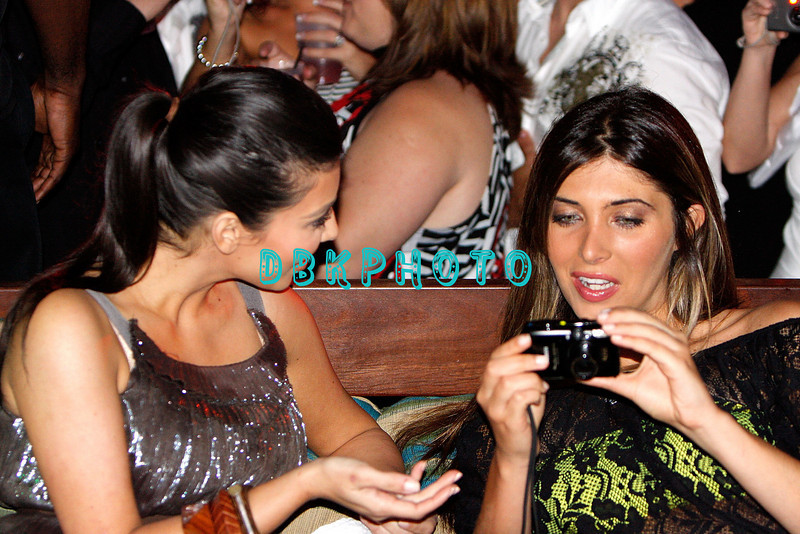 ATLANTIC CITY, NJ - MAY 23:  Kim Kardashian (L) and  Brittny Gastineau look at photograph they took of themselves at The Pool at Harrah's Resort on May 23, 2009 in Atlantic City, New Jersey.