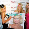 ATLANTIC CITY, NJ - JUNE 13:  Paris Hilton (L)  signs a photo for fans as she visits the Club mur.mur at the Borgata Hotel Casino & Spa on June 13, 2009 in Atlantic City, New Jersey.