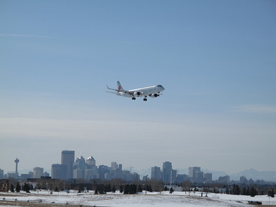 Air Canada Emb 175 on finals #34 with city in background. 2007-02-17