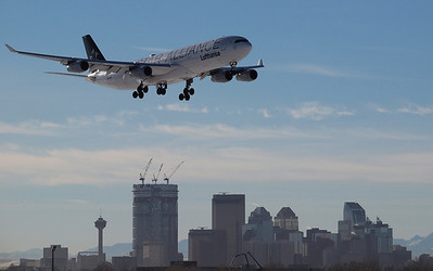 STAR Alliance 330 on short finals to 34 with city of Calgary skyline in the background.