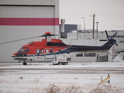 C-GOSE Super Puma. She was doing engine runs and blew up quite the snow storm. A short while after shutting down they opened the cowls and towed her inside, no doubt the crew were glad to get her into the relative warmth of the hangar after -25C outside.