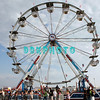 ATLANTIC CITY, NJ - JUNE 24: Fans enjoy a ferris wheel ride between the changes of bands who performs during the Dave Matthews Band Caravan at Bader Field on June 24, 2011 in Atlantic City, New Jersey.