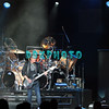ATLANTIC CITY, NJ - AUGUST 11: L-R Jonathan Cain, keyboards, Arnel Pineda lead singer, Ross Valory, bass and Neal Schon, guitarist for the band Journey performs in concert at the Ovation Hall at Revel Resort & Casino on August 11, 2012 in Atlantic City, New Jersey.