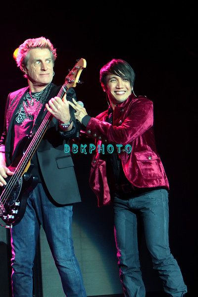 ATLANTIC CITY, NJ - AUGUST 11: Ross Valory, bass  and Arnel Pineda lead singer for the band Journey performs in concert at the Ovation Hall at Revel Resort & Casino on August 11, 2012 in Atlantic City, New Jersey.