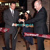 "ATLANTIC CITY, NJ - JULY 25:  L- R Steve Heeley, President /COO of Earl Of Sandwhich, Nicole ""Snooki"" Polizzi and Kevin Ortzman, Senior Vice President and General Manager of Bally's & Showboat attends the Earl of Sandwich Showboat Casino Grand Opening ribbon cutting ceremony on July 25, 2012 in Atlantic City, New Jersey"