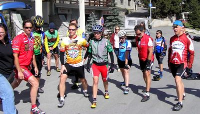 Cyclists are lead in a warm-up during lunch