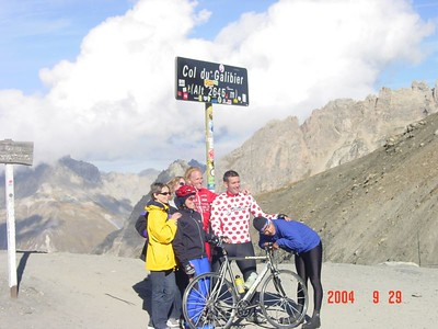 "Mike Zimits (in polka dot jersey) on the top of the Galibier:  ""6 years ago they told me I would be in a wheelchair, and today I climbed to the top of the world"""