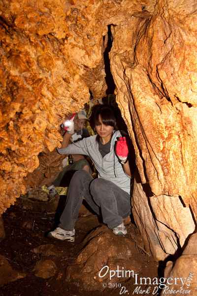 Jeong-Ah bravely enters into the first cave, checking to see if it is safe for Brad to come in.