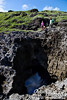 """Spotlight Cave has a huge, totally submerged opening to the Pacific Ocean.  The cavern narrows from front to back.  About half way back is this skylight hole, which (around noon) allows a beam of light to penetrate down through the cave.  For photos from inside the cave, see the following link:    <a href=""""http://www.optimimagery.com/THE-UNIVERSE-BENEATH/FUN-DIVES-AND-DIVE-BUDDIES/Banzai-and-Spotlight-Cave/8379517_rJuWW"""">http://www.optimimagery.com/THE-UNIVERSE-BENEATH/FUN-DIVES-AND-DIVE-BUDDIES/Banzai-and-Spotlight-Cave/8379517_rJuWW</a>"""