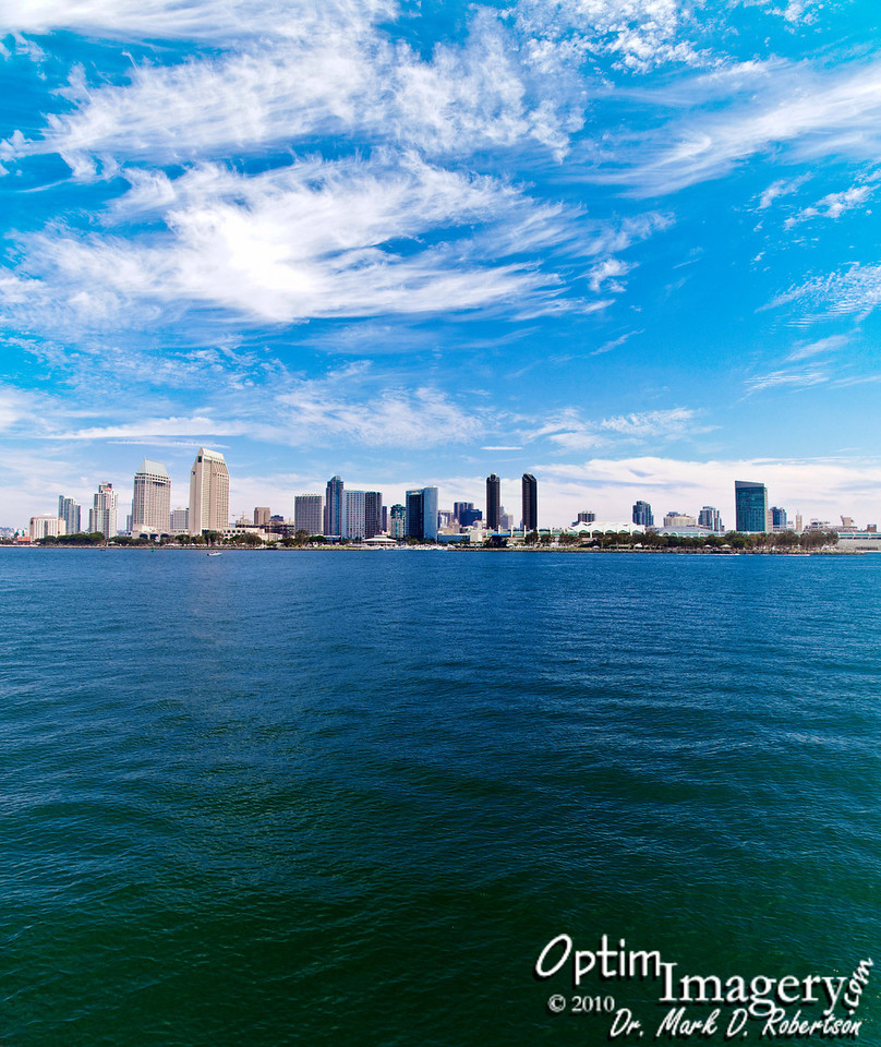 """Looking back at San Diego as we approach Coronado.  This is actually a vertical panorama.  I you would like to see detail, click on the photo, and then click on the """"O"""" which appears at the top center of your screen.  DO NOT CLICK ON THE ENLARGED PHOTO UNTIL YOU ARE READY TO RETURN TO THIS SCREEN.  You will have a scroll bar to your right and at the bottom of your screen.  These will be necessary, because the full-size photo will take up several of your screens.  When you are ready to return here, just click on the full-size photo and it will clear."""
