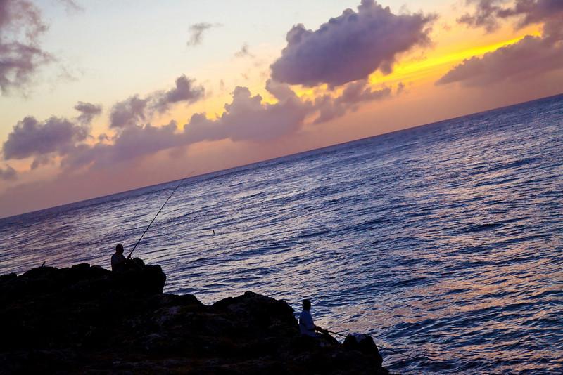Fishermen in the sunset.