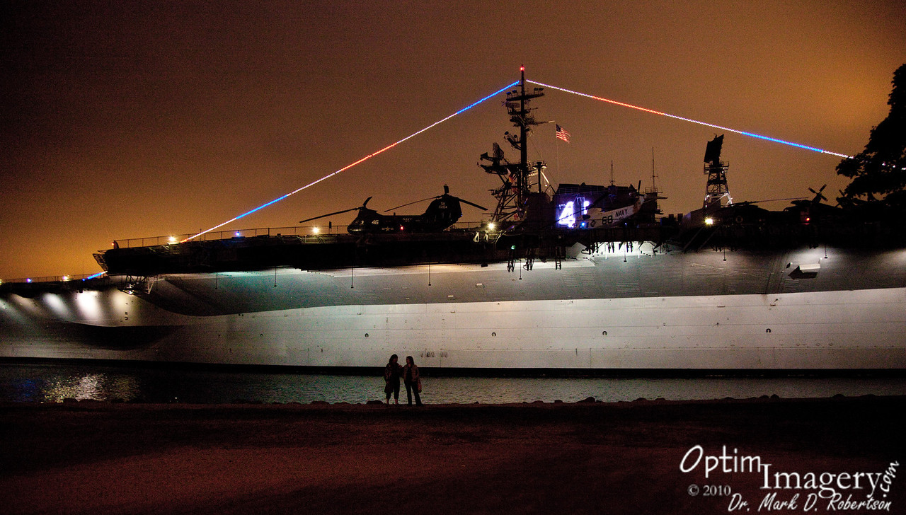 Side view of the U.S.S. Midway at night.
