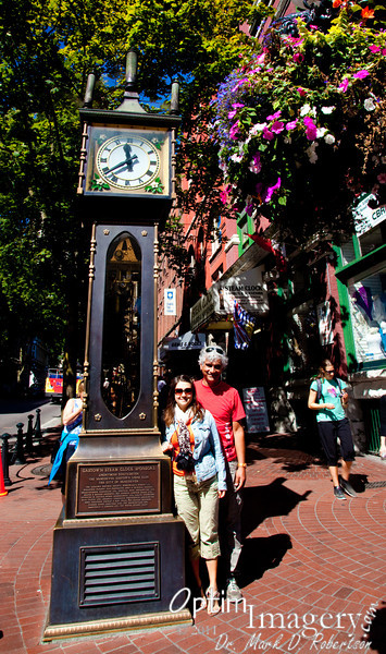 Gastown steam clock.  There are steam pipes under the sidewalk used for heating in local businesses.  Some of the steam also is used to run a little engine at the base of this clock.  The engine turns a pulley, which drives a chain, which lifts metal balls to the top of the housing.  Gravity then pulls on the balls and keeps a pendulum in motion to directly power the clock mechanism.