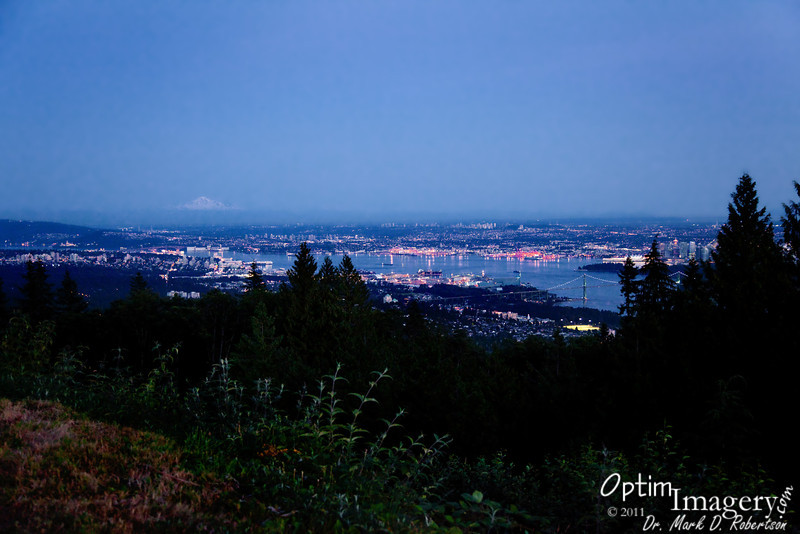 We've made land, checked into our motel, and headed up Cypress Bowl (ski area) Drive to get a great view of Vancouver as the sun sets.  You can still see Mount Baker rising above the city.