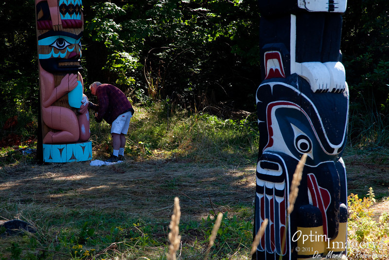 We were lucky enough to see one of the tribal members sprucing up one of the poles.