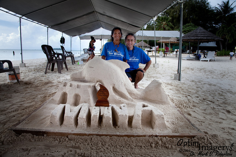 Ron and Moon stand next to their masterpiece.  They won third place!