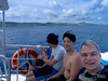 I didn't count to see how many were on this trip, but it was more folks than I have ever dived with before.  Here you see Bob (nearest us) enjoying time on the top deck, with Saipan in the background.