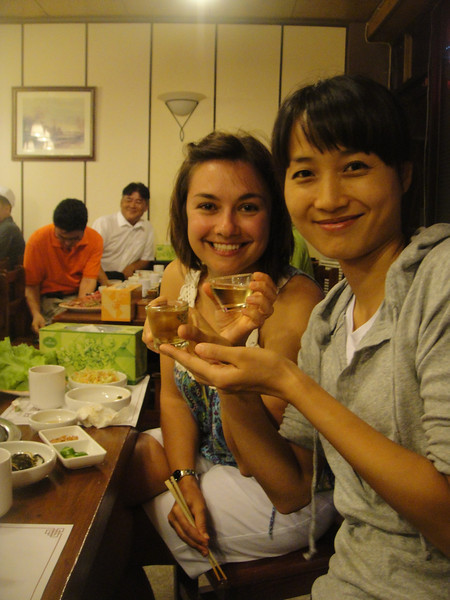 Olga and Jungha sharing rice wine