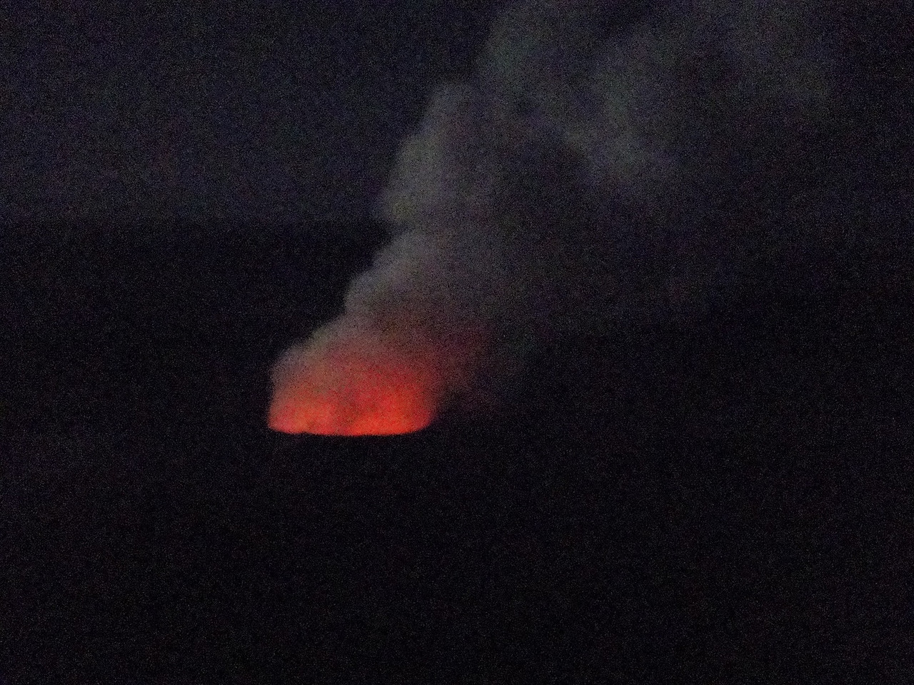 What a treat to get to see this our first night at Volcano.  The backdrop of the full moon was wonderful.