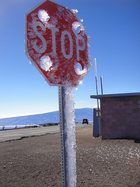 ice balls were melting and blowing off the telescopes onto the car on occasion...see them behind the stop sign on the right?  Holy signs so the wind doesn't blow them over.
