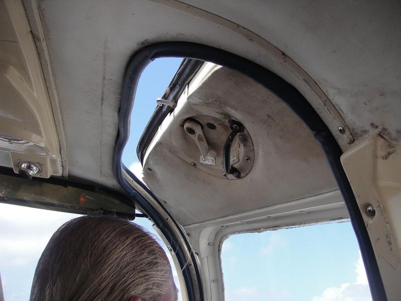 The door stays open till we're in the air....runway breeze never felt so good!