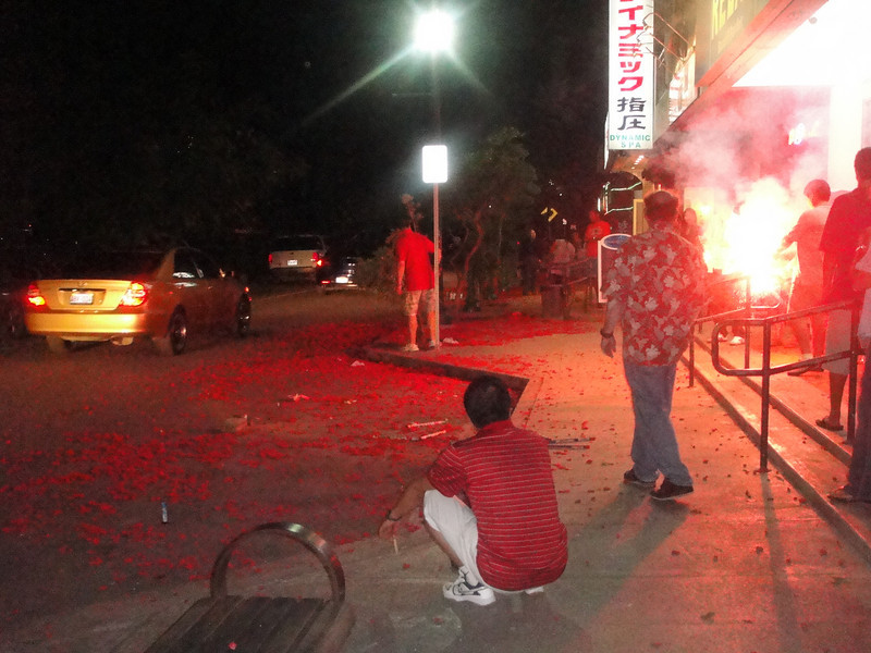 all the red is just the leftovers of the firecrackers.....it looked this way looking both directions....and there were several blocks around the 'city square'.  Fun night.