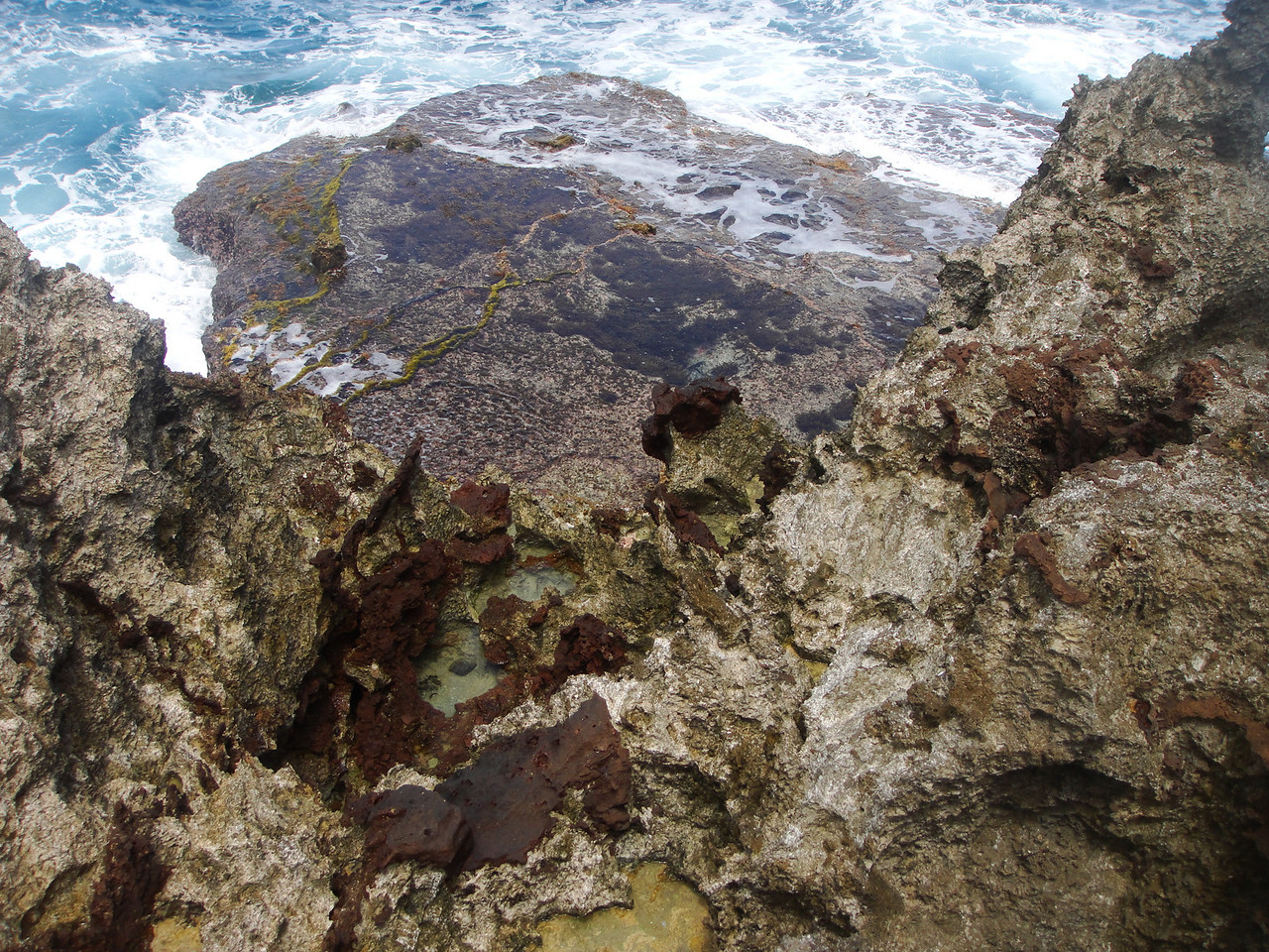 Many of these little tidal pools had bubbles coming up with each wave.  It's a very porous coral reef..