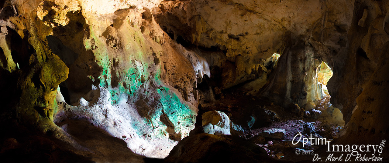 """This is a 9-panel panorama from the same location as the previous photo.  The large """"doorway"""" to your left with the little volcano-shaped stalagmite is the entryway to Eileen's Chamber.  If you are interested in seeing detail here, hover your cursor over the photo and click on """"Original"""" in the resulting pop-out menu.  That will open a full size photo, which will not fit on your screen.  Navigate with the scroll bars which will be at the right margin and bottom of your screen.  If you then click on the full-size photo, that will return you to this SmugMug album view.<br /> <br /> All of this is also from ambient light, with shots varying from 3.5 seconds to 30 seconds.  This photo probably took about an hour to shoot (several shots are taken for each panel at each shutter speed to allow combination in such a manner as to reduce digital noise {a pesky problem with long shutter speeds} -- then after each panel is prepared in Photoshop, the panels are combined to form the panorama)."""