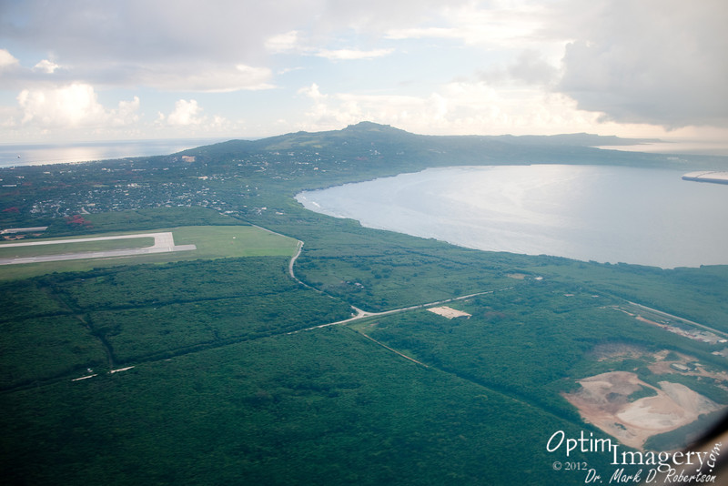 Saipan airport.  Mount Tapachau.  LauLau Bay.