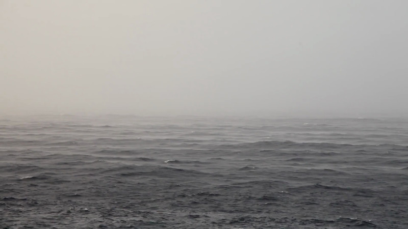 """As you can see, as I approached my place to set up the tripod, there was a bit of a storm which came by.  Luckily, it was small, slightly off shore, and it paralleled the shoreline instead of coming at me (although it did rain a little, as you can see if you watch the video closely).<br /> <br /> At about 45 seconds in, you will see the seaward end of the tunnel from last video.  It's interesting how the waves shoot up and slam against the roof of the tunnel to create the """"dragon's smoke and breath"""" that you saw and heard in the previous video.<br /> <br /> At about 1:40 the video transitions to where I took the photos.  The camera is sitting on the tripod ready to go.  Then, after I've taken a few shots, I pan the camera around to show some of the clouds.  And you can see that the sun is about to set."""