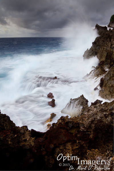 """This is the same formation as shown in the photo from the previous night  <a href=""""http://www.optimimagery.com/CNMI-ON-LAND/SAIPAN-2013/SEPTEMBER-16-2013-EL-TORO/31909809_gKXfr5"""">http://www.optimimagery.com/CNMI-ON-LAND/SAIPAN-2013/SEPTEMBER-16-2013-EL-TORO/31909809_gKXfr5</a>) but I'm south of it looking north this time.  Pretty much just after I got enough exposures to be able to put this one together, it started raining full force.  As you could see from the previous shots, closing up is not an instantaneous thing:  It takes time to put up the camera, fold up the tripod, roll  up the rope, etc.  I was quite wet by the time I got back into the """"protection"""" of the forest.  It kept raining for quite a while, so it was indeed time to leave.  But I do think I got a decent shot.  What do you think (feel free to comment below -- or on Facebook)?"""