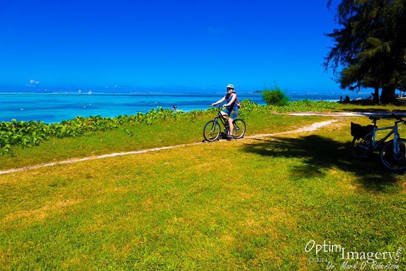 Leisurely ride along the water's edge at American Memorial Park, Saipan.  You can see windsurfers and Managaha Island in the background.