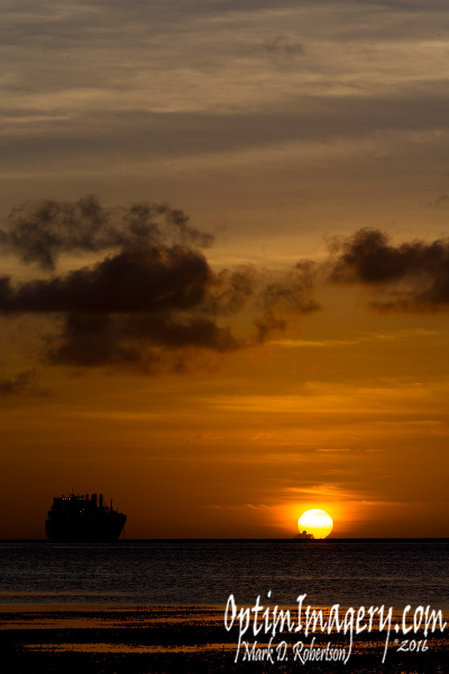 """For any of you who don't know, there are these huge """"readiness ships"""" anchored just off shore from my place.  They are chock full of large military equipment (including tanks, helicopters, fuel trucks, etc.) and are ready to pull up anchor and head for hostilities on a moment's notice."""